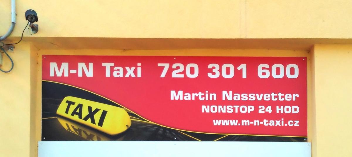 M-N Taxi - Reklamní cedule na fasádu